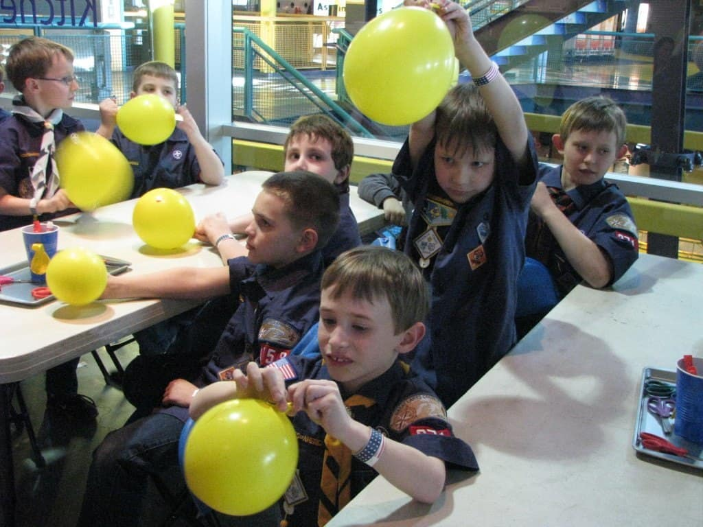 Boy scouts learn about static electricity with balloons