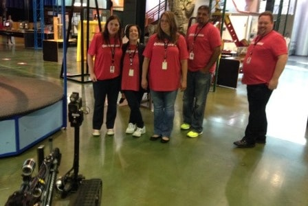 Volunteers from Quicken Loans work with robots