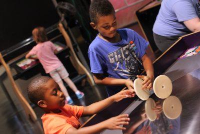Two children explore an exhibit
