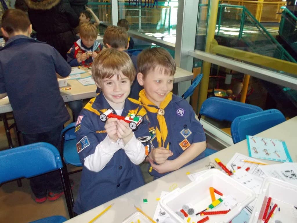 Two boy scouts show off a LEGO car creation