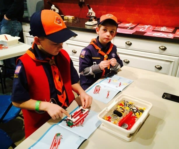 Two boy scouts learn about simple machines by building with LEGO bricks