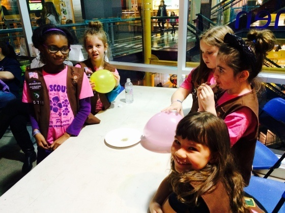 Girl Scouts use balloons to learn about static electricity