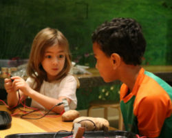 Two students discuss their science experiment