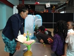 Dr. Tonya Matthews talks with students visiting the science center