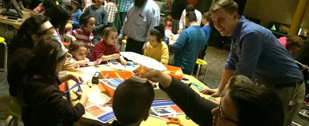 Families enjoy hands-on activities in Spark Lab