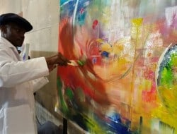Artist Timothy Orikri creates a painting