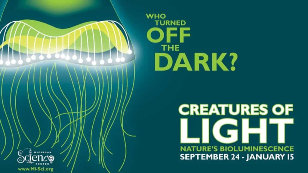 An ad for the Creatures of Light exhibit featuring a jellyfish
