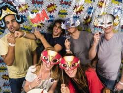 Adults pose dressed as superheros