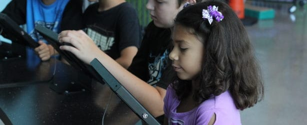 Children learn about computer coding using tablets