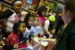 Children watch a science demonstration