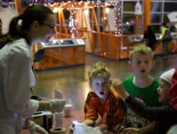 A group of children enjoy a science experiment